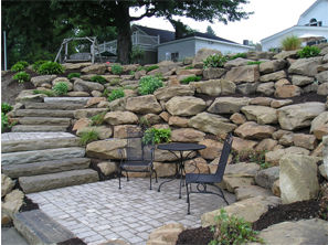 5 Retaining Wall Block Options For Your Landscape Tiered Landscape Boulder Retaining Wall Rock Retaining Wall