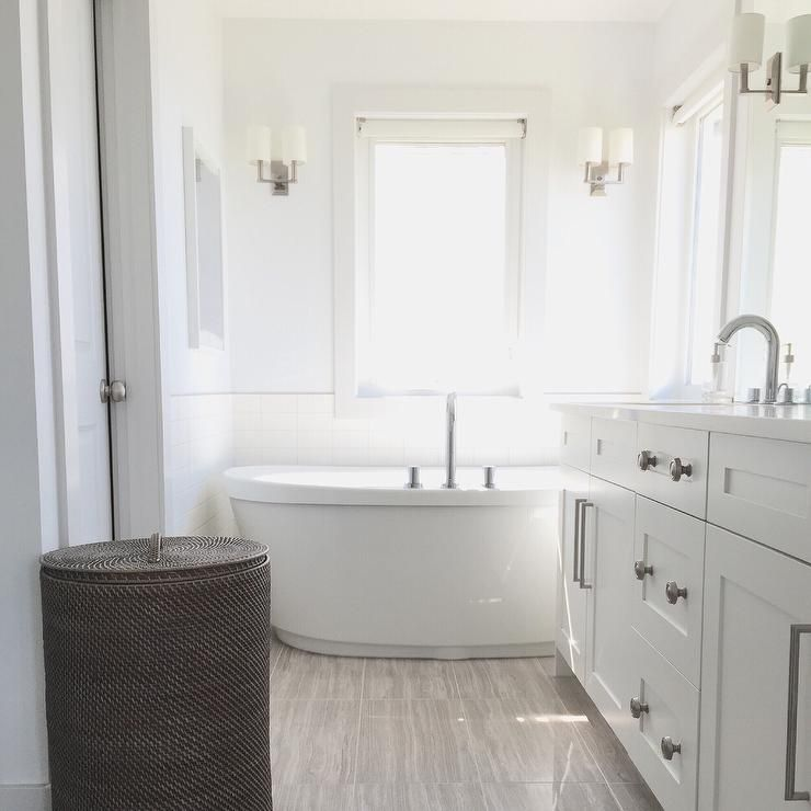 Lovely Bathroom Features A White Dual Washstand Topped