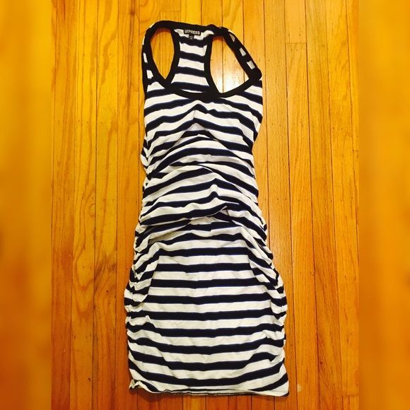 Express Casual Dress Stripes Express dress. Color of the dress is black, blue and white. The dress scrunch up on the side near the bottom. I wear this once at the beach. Express Dresses Midi