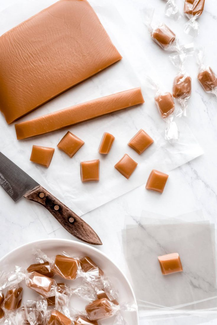 Soft, creamy, melt-in-your-mouth Homemade Caramels are the perfect holiday gift! Package them up and enjoy this heavenly candy all season long. #caramel #homemadecandy #christmastreats | GarnishandGlaze.com
