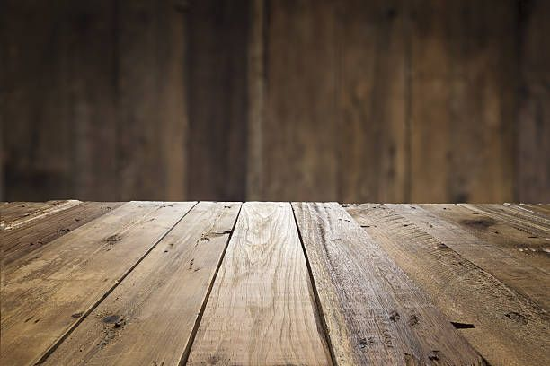 Empty wood table with defocused vertical table background for Table background