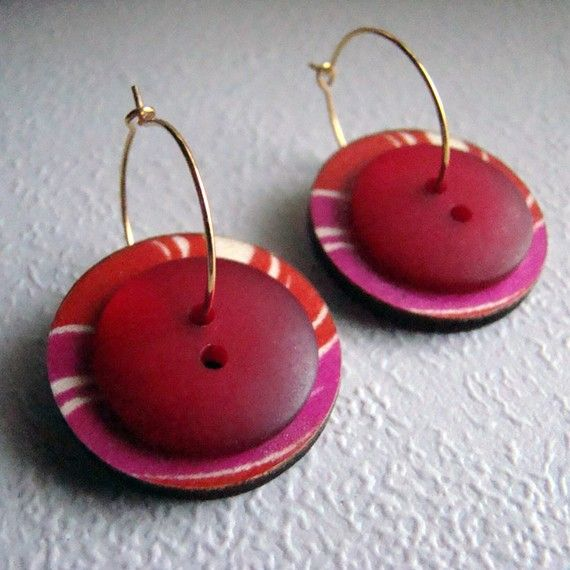 Wood and plastic buttons on 3/4 gold tone wire hoops. Larger button is 1 diameter