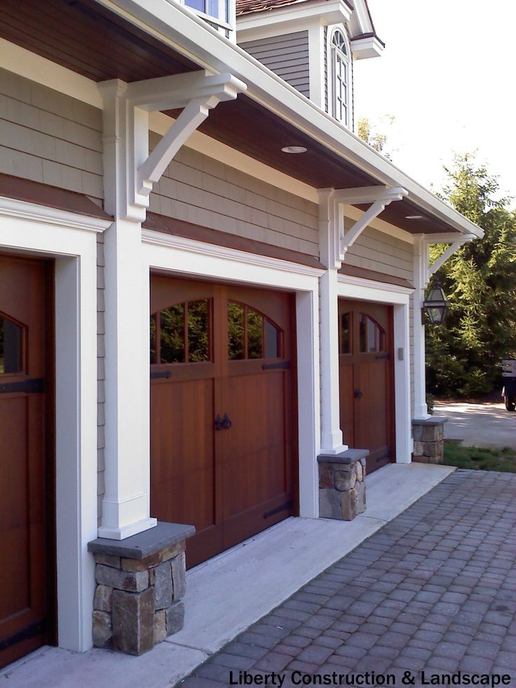 Rustic 3 Car Garage With Half Rounded Windows Above The Average Price To Install A New Door Is 964