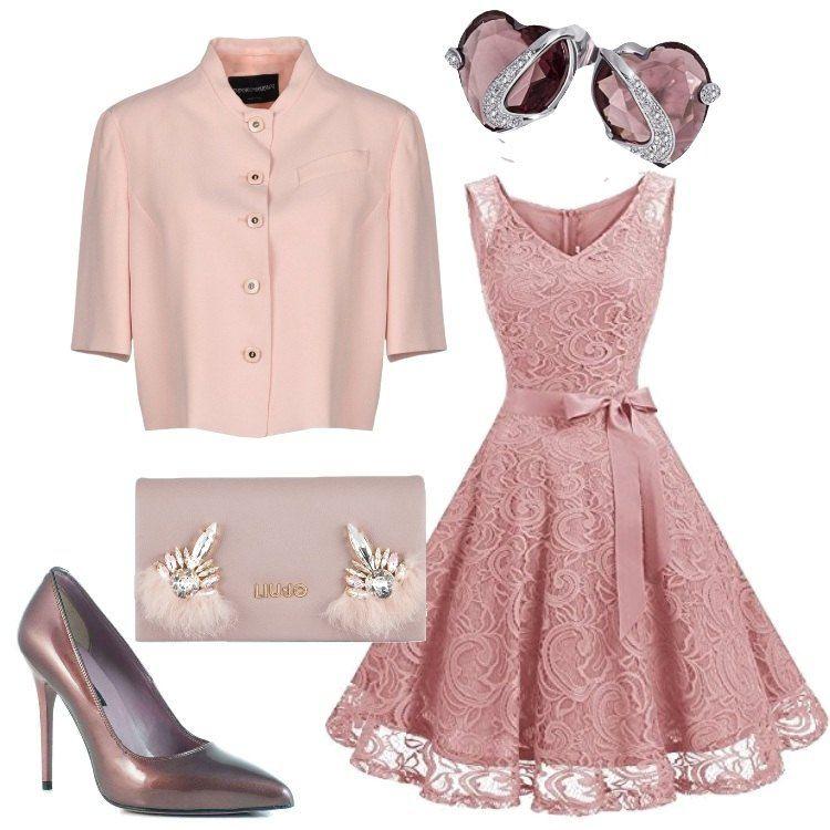 e6e887c240 Un romantico vetsito in pizzo rosa con cintura da annodare in vita viene  abbinato ad una giacca corta con manica a tre quarti.
