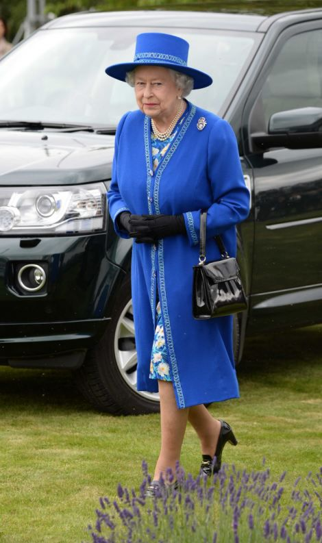 The Queen looked elegant in a royal blue Angela Kelly dress and jacket as she attend the Cartier Queen's Cup Final at Guards Polo Club, 15.06.2014 in Egham, England