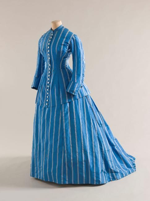 This is a good example of an 1860's dress with two different bodices- one for day and one for evening.