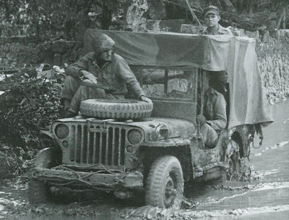 On Okinawa the the canvas top protected the wounded against the torrential rain. Note the camouflage scheme painted on the canvas.