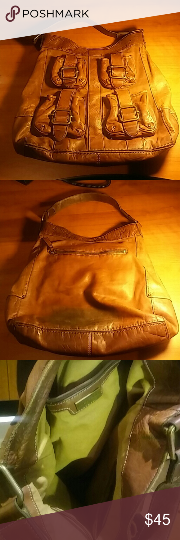 Brown leather purse Large Brown leather Distressed Banana Republic Shoulder bag 4 Front Pockets with Magnetic closure, zip pockets inside and on the back of the bag. Measurements heught 12 1/2 inches, width 17 inches. Banana Republic Bags Shoulder Bags