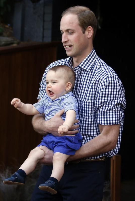 Britain's Prince William holds his son Prince George after meeting a Bilby, during a visit to Sydney's Taronga Zoo