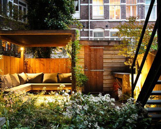 contemporary back garden designs with wooden patio theme also