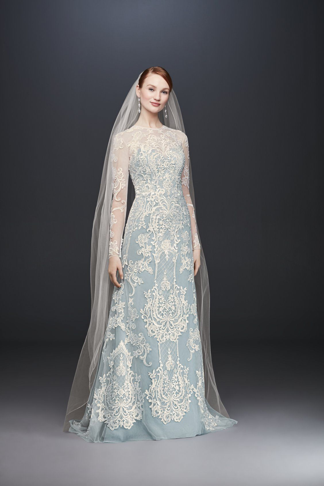 b24af3367e0 Something blue wedding dress with cloud blue column sheath and long sleeve  lace overlay by Oleg Cassini available at David s Bridal