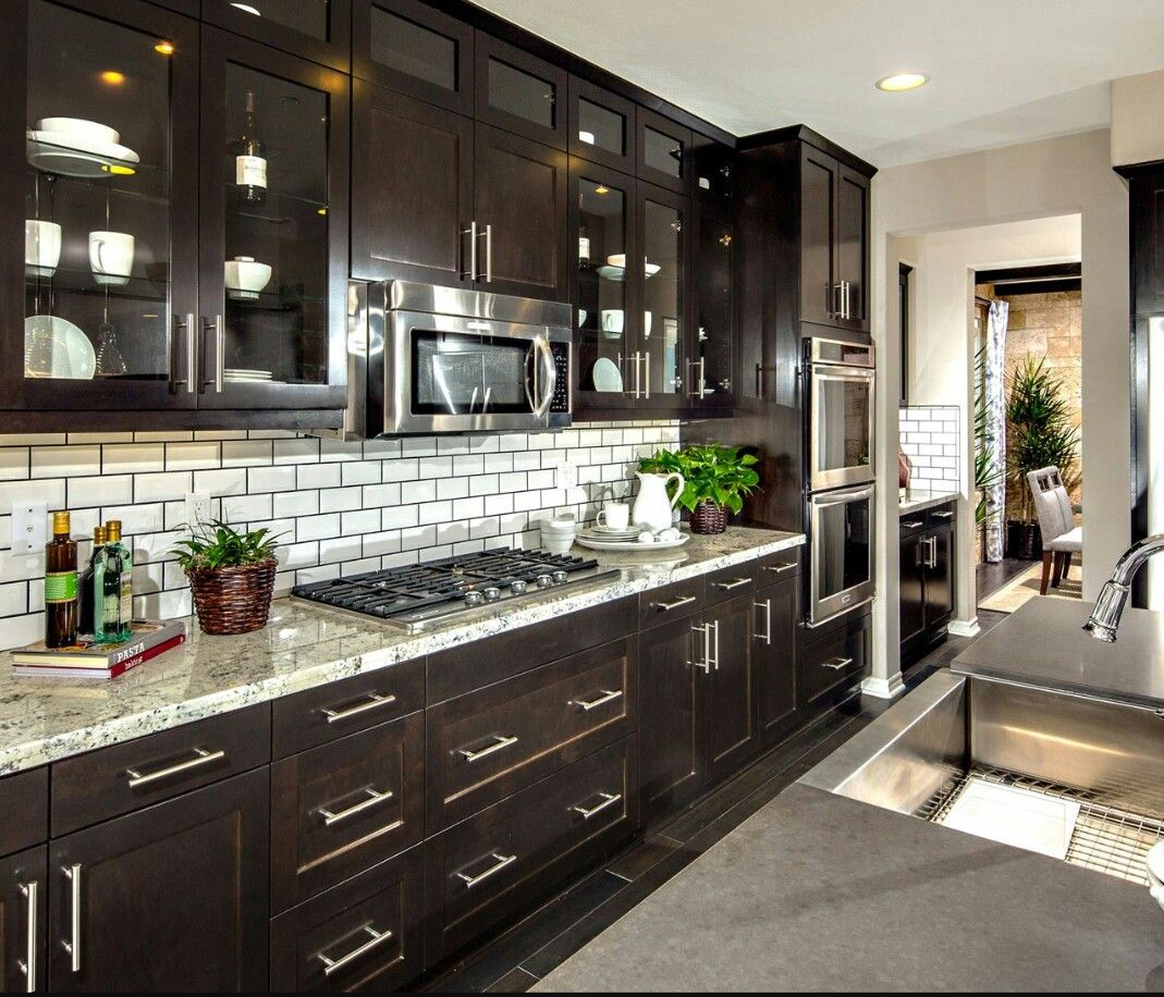 dark cabinets and white subway tile with dark grout
