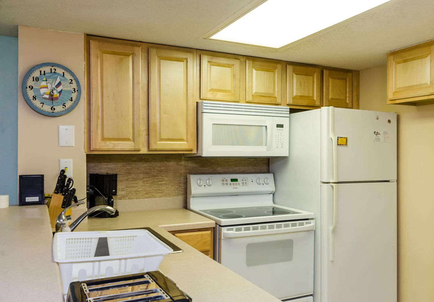 Cooking made easy in this fully equipped kitchen Home