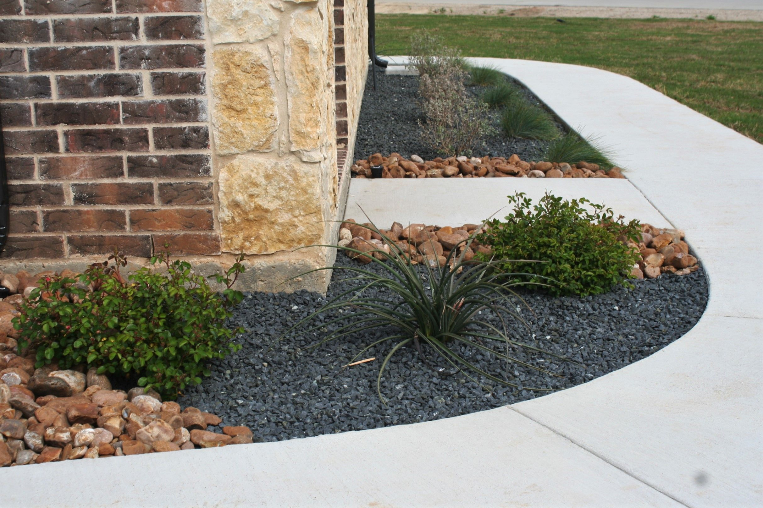 Black Star Gravel And Texas River Rock Flowerbed Landscaping