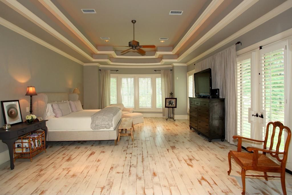 Traditional Master Bedroom - Come find more on Zillow Digs! Shutters and French doors are a must for a master.