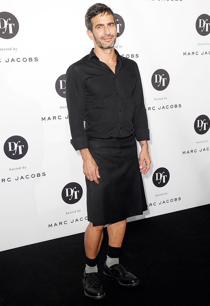 2a43f24acf Marc Jacobs wearing a black pleated kilt and a black button-down shirt