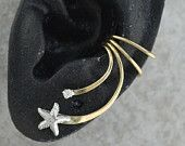 Ear Cuff - Graceful Feathers -  Sterling Silver and Gold Filled - SINGLE SIDE. $33.00, via Etsy.