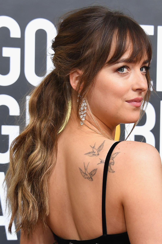 6a058e69a3be8 Dakota Johnson shoulder bird tattoo   Tattoos   Hair styles, Long ...