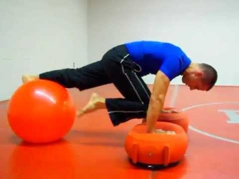 Single Leg Scissor Knee Tucks On Korefit And Stability Ball Beyond Fitness Stability Ball Ball Ball Exercises