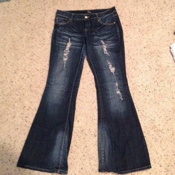 """Distressed dark wash jeans Distressed dark wash jeans. Very slight wear on bottoms as shown in second picture. Inseam measures 31.5"""". Jeans"""