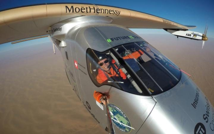 Bertrand Piccard takes a 'selfie' during the last leg of the round the world trip with Solar Impulse 2 over the Arbab peninsula prior to landing in Abu Dhabi to finish the first flight around the world without the use of fuel