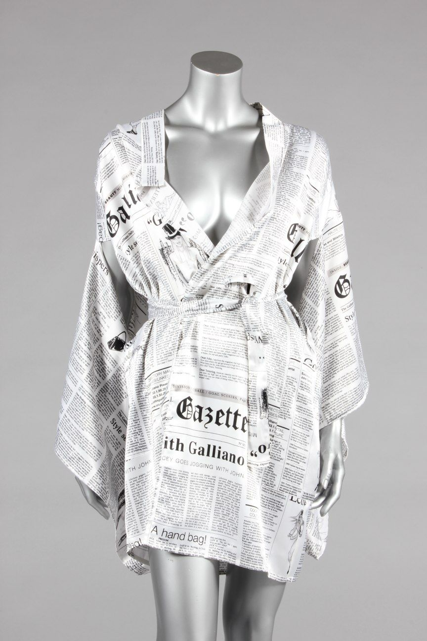 464cde10 A John Galliano printed satin kimono jacket, 2000, covered with newspaper  print detailing the designer's career including his birth date, tie belt.