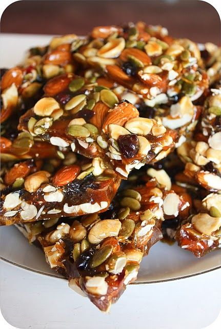 Autumn brittle,1 Cup Almonds  1 Cup Cashews  3/4 Cup Pumpkin Seeds  2/3 Cup Dried Cranberries   1 1/2 Cups Golden Brown Sugar  1 Cup Granulated Sugar  1/2 Cup Honey  1 Cup Water  1/2 Teaspoon Salt  1 Tablespoon Butterc