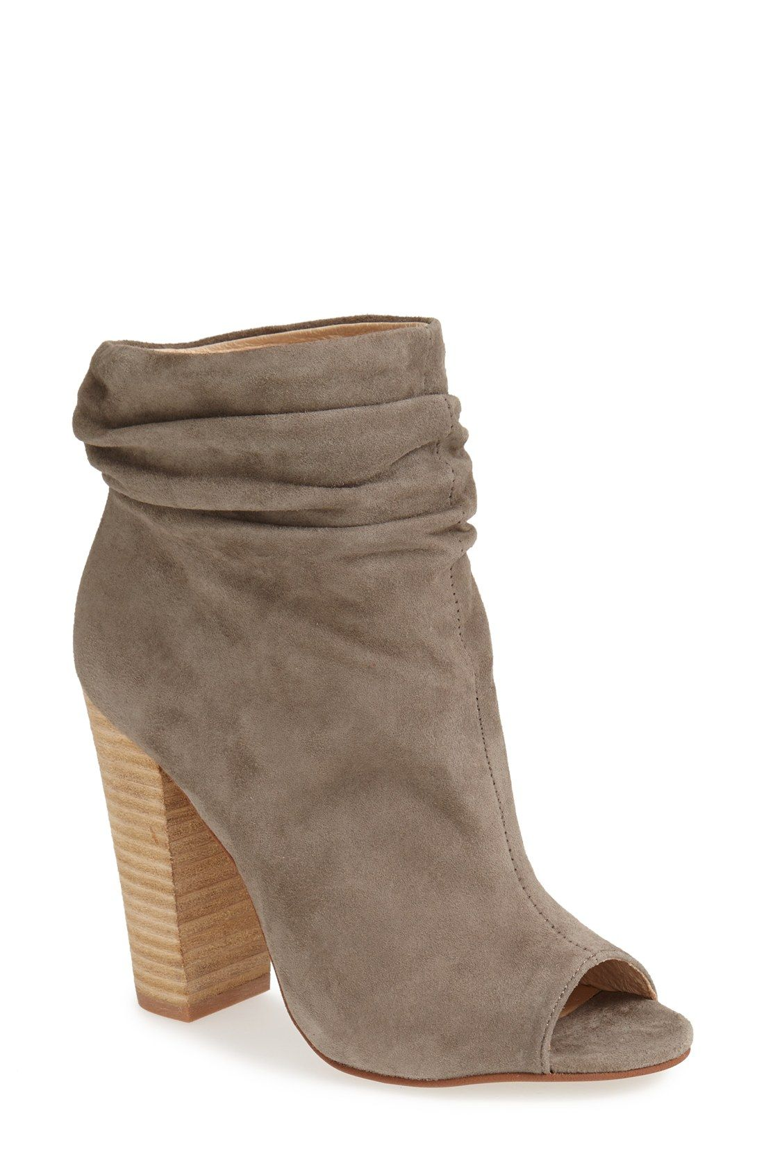 Gentle ruching gives a stylishly slouchy look to this on-trend bootie with a flirty peep toe.