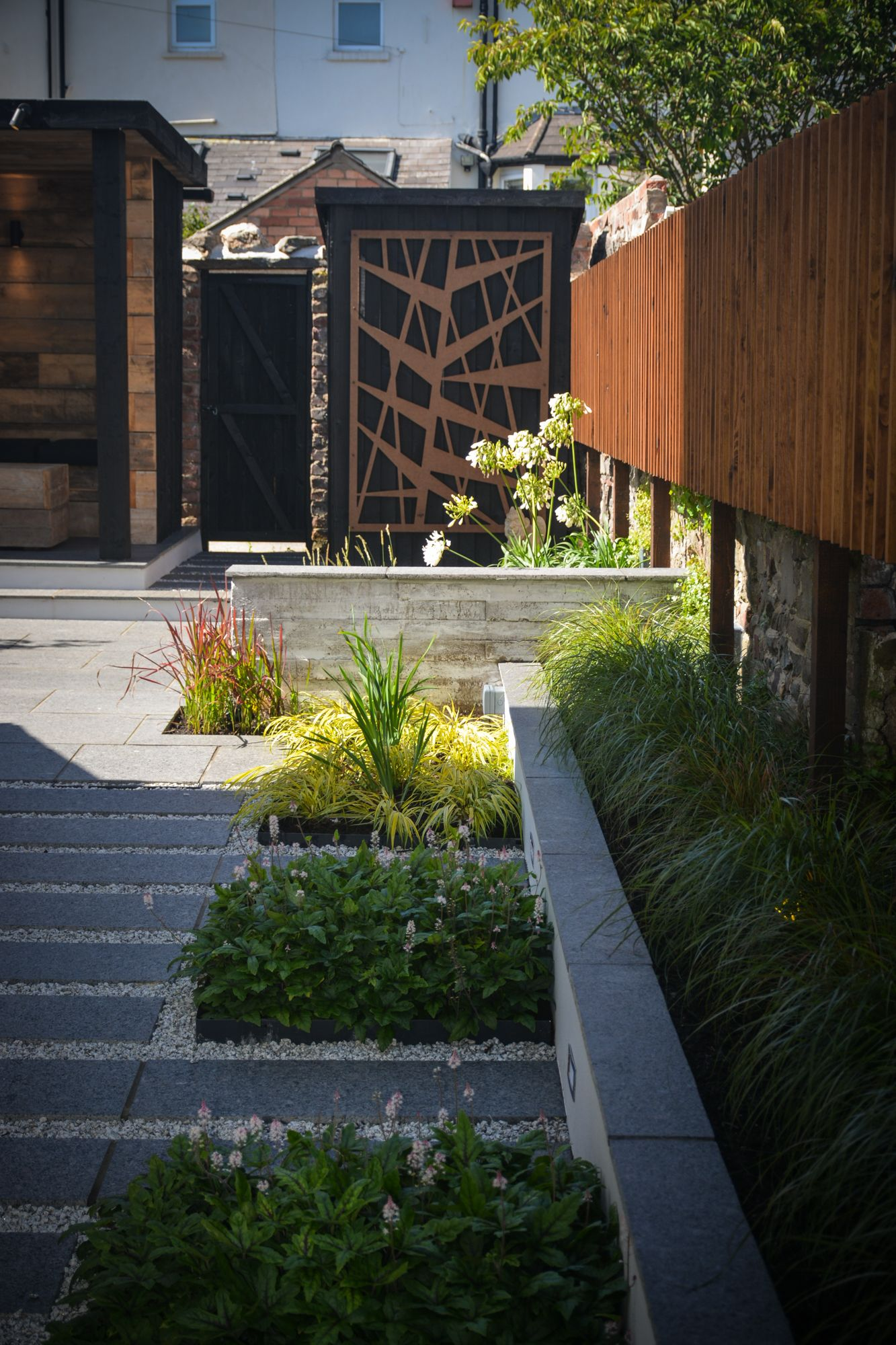 industrial modern garden with concrete shutter board wall and
