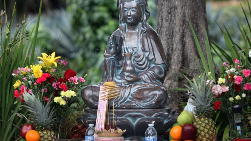 A Buddhist statue was meant to simply ward off trash and graffiti on a rough Oakland corner. But it became a community gathering place for the area's Vietnamese immigrants, who turned the site into a beautiful shrine.