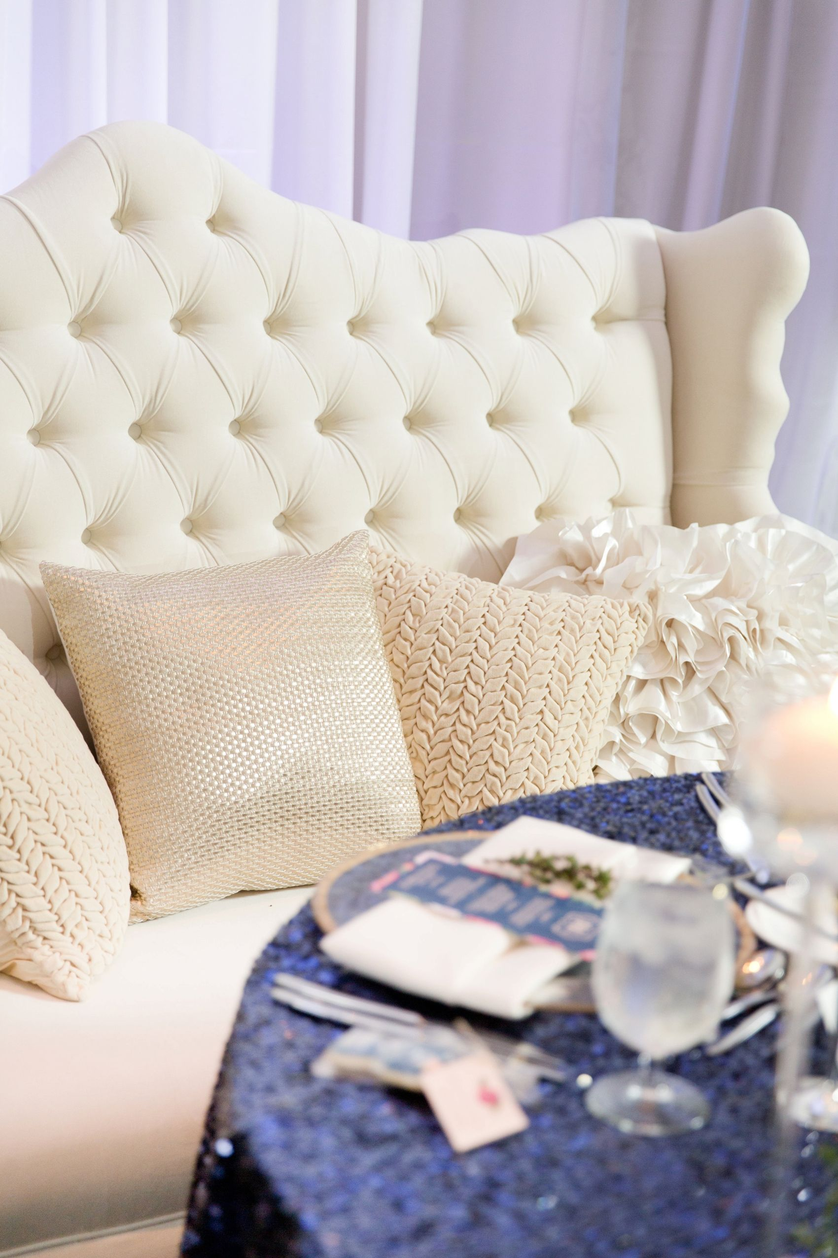 Desert Sanctuary on Camelback wedding. Gorgeous blush and navy color scheme, with lush white and pink florals.  And for the sweetheart table there was a cream colored tufted wing back love seat!