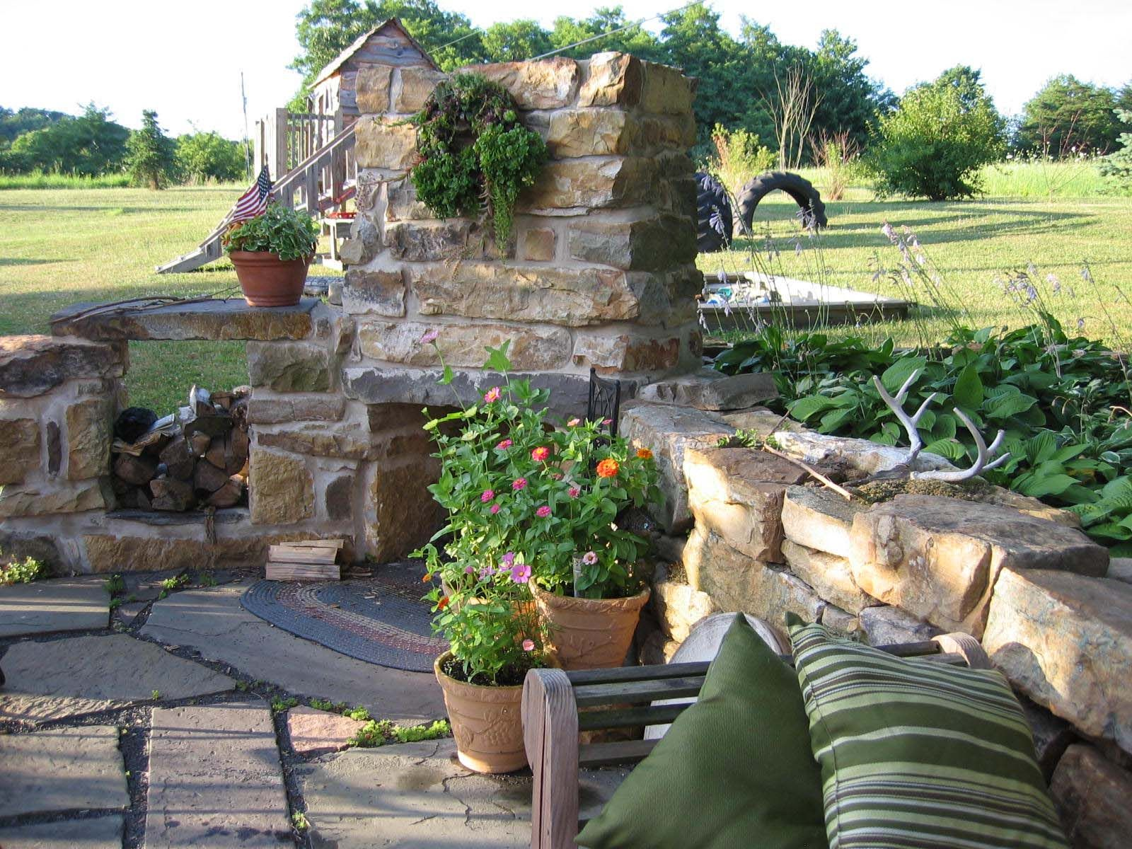 Slate patio and outdoor fireplace made of foundation stones from