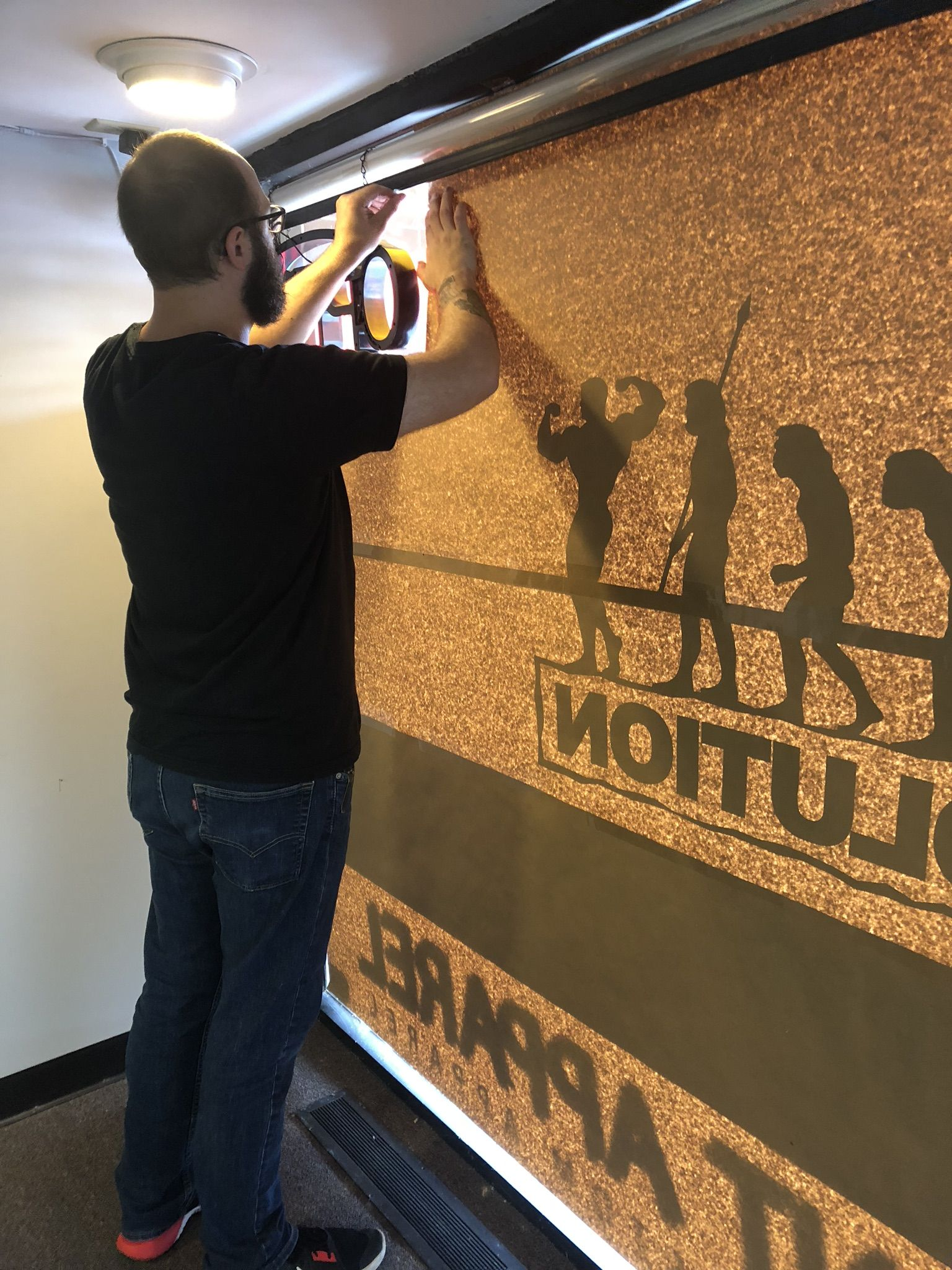 Preparing The Vinyl Sign For Our Window Custom Screen Printing Screen Printing Design Your T Shirt