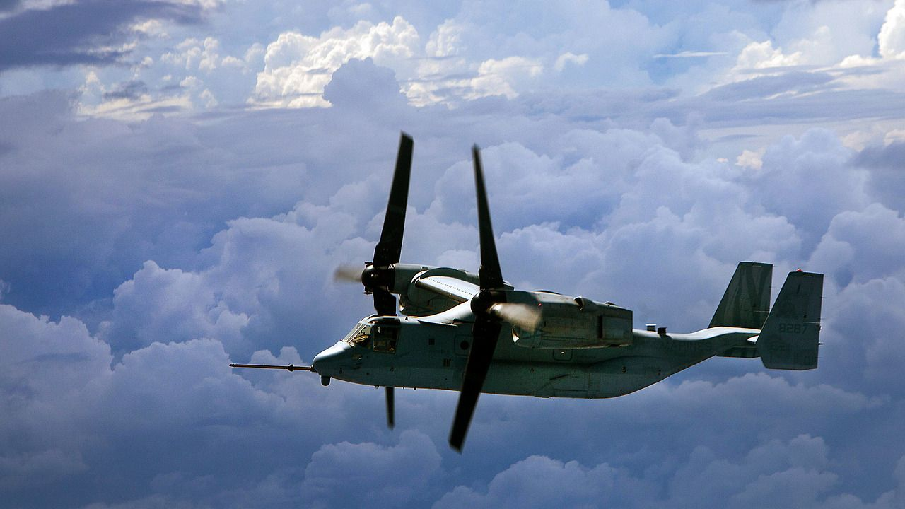 An MV-22 Osprey from Marine Medium Tiltrotor Squadron 262 soars over the Pacific Ocean during a flight from the Philippines to Australia Nov. 8, 2014.