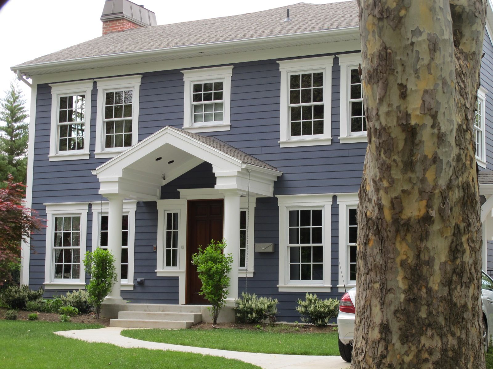 Exterior update blue siding white trim wood door for Colonial window designs