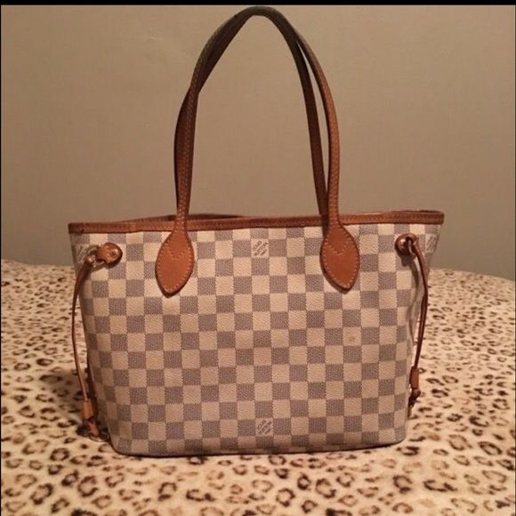 100% authentic damier azur neverfull PM Pre-owned bag used it is in good condition. It shows some normal sign of usage. No rips or smells. Handles are darkened with patina color natural. Thank you for your interest and if any questions please don't hesitate and ask!!! Louis Vuitton Bags Totes