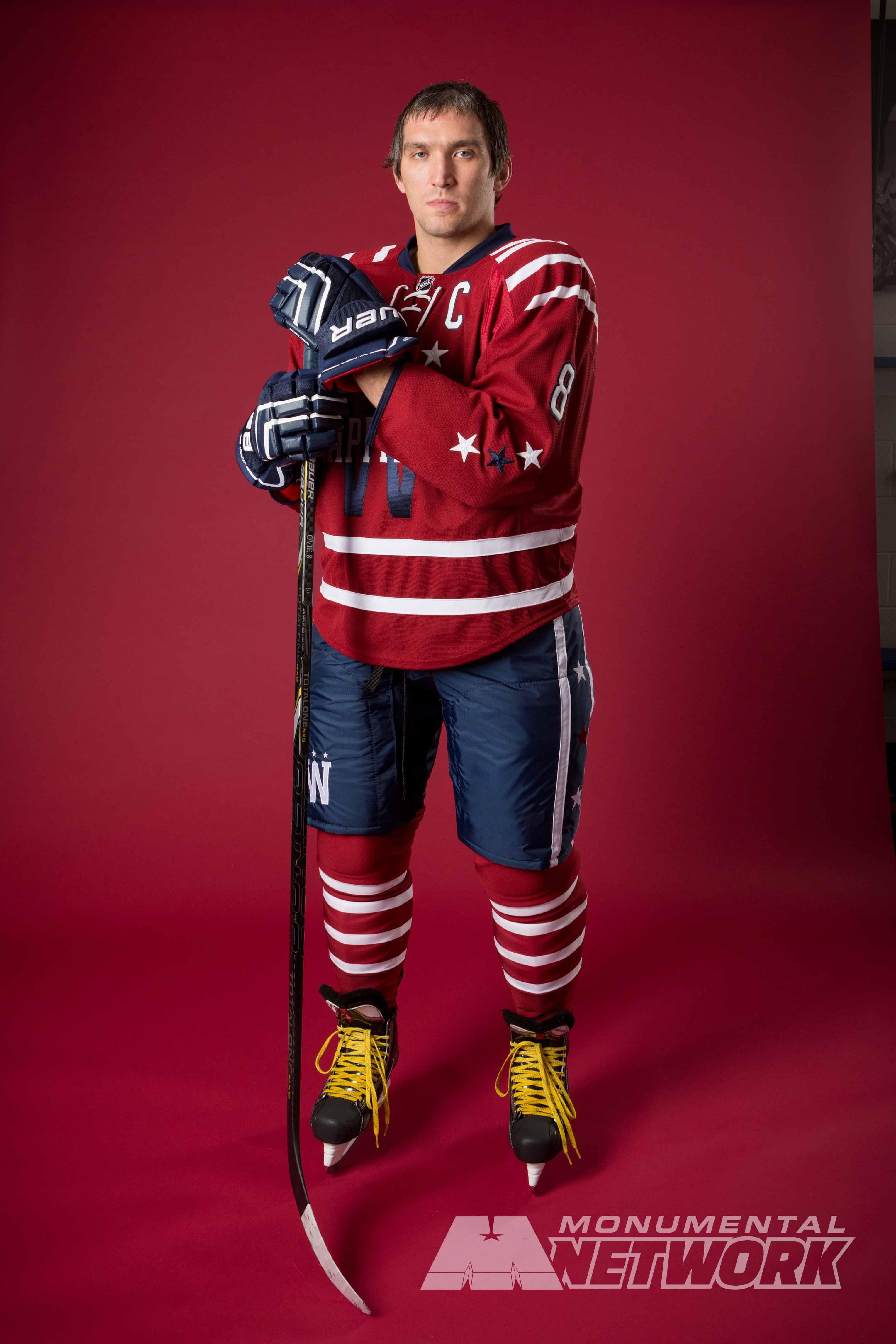 1229dff09d1 Washington Capitals captain Alex Ovechkin shows off the Caps' 2015  Bridgestone NHL Winter Classic® jersey