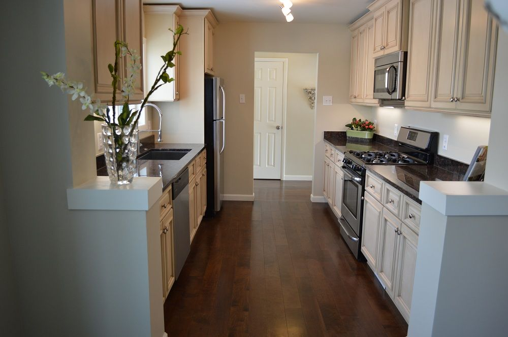 Complete house remodel before and after pictures for the for Galley kitchen remodels before and after