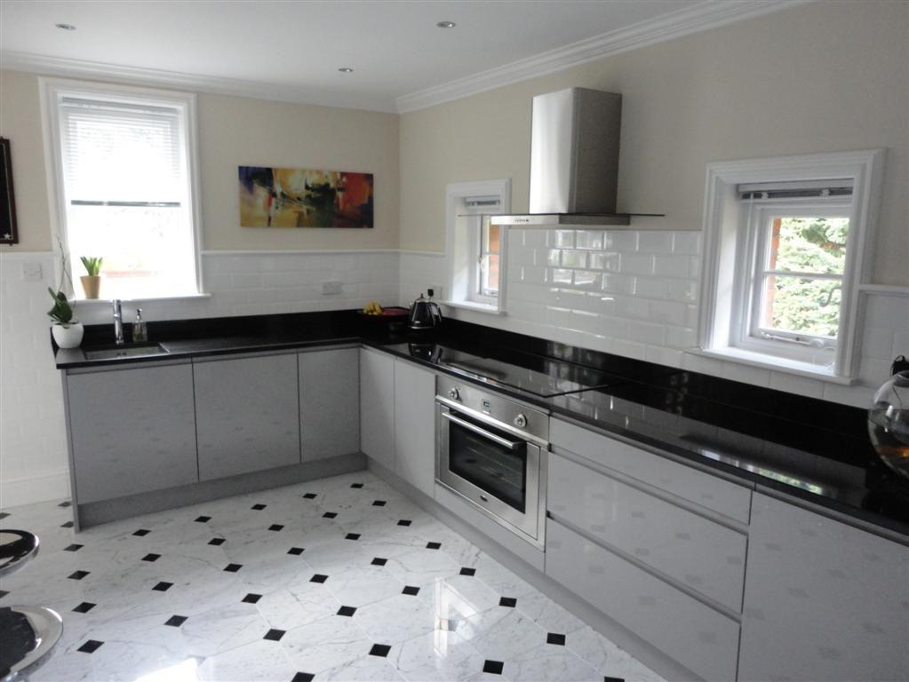 Grey Gloss Kitchens - Light grey gloss kitchen cabinets