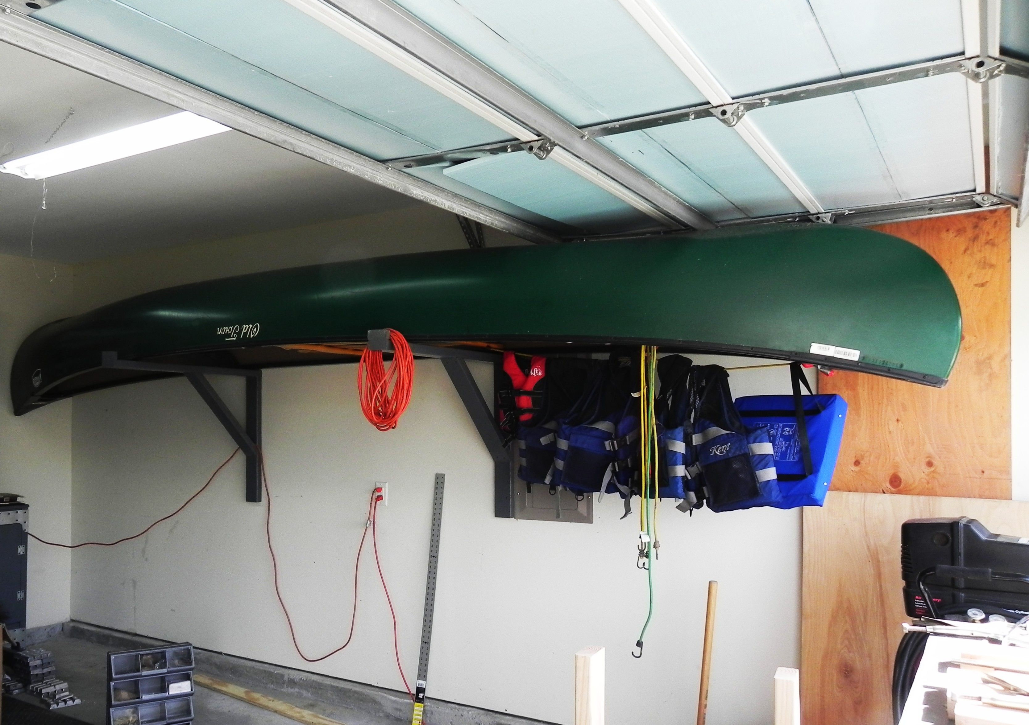 How To Hang A 17 Ft Canoe In A 19 Ft Garage. The Canoe Is Just Low Enough  Where The Garage Door Can Open And Close With Out Hitting It.