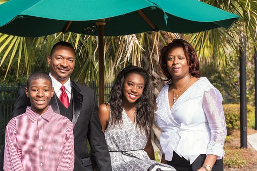 Happy Black Family Vacation Resort Portrait