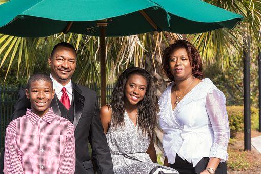 Happy Black Family Vacation Resort Portrait