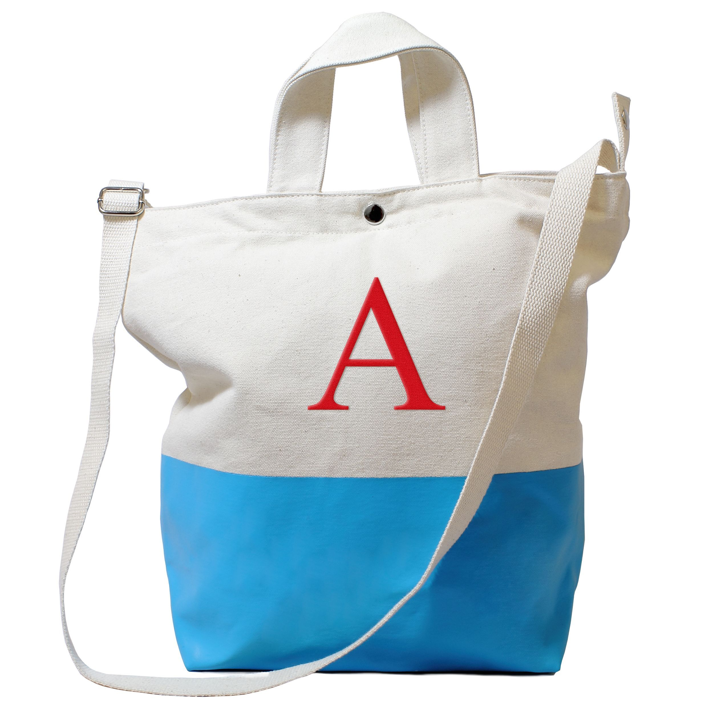 One of today's hottest bag for the modern girl on the go, this matte aqua latex-dipped natural canvas tote bag is a flawless combination of form and function. The oversized shoulder bag features two wide carrier handles for comfort.
