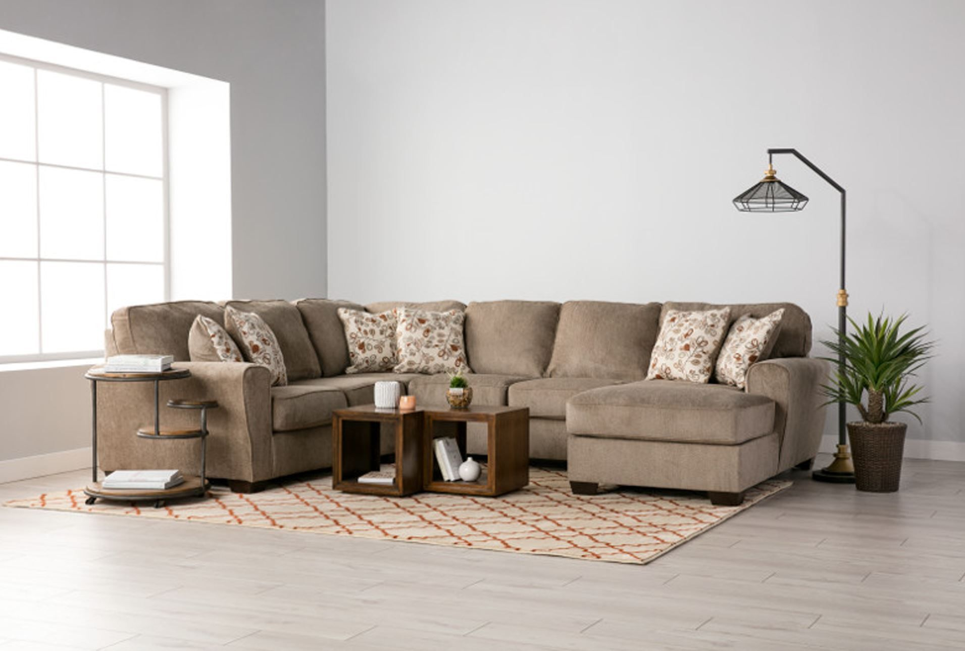 Patola Park 4 Piece Sectional Wraf Corner Chaise Living Spaces