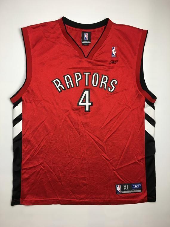 huge selection of e0f8f 4c0de 1990s Vintage Toronto Raptors Chris Bosh Basketball Jersey ...