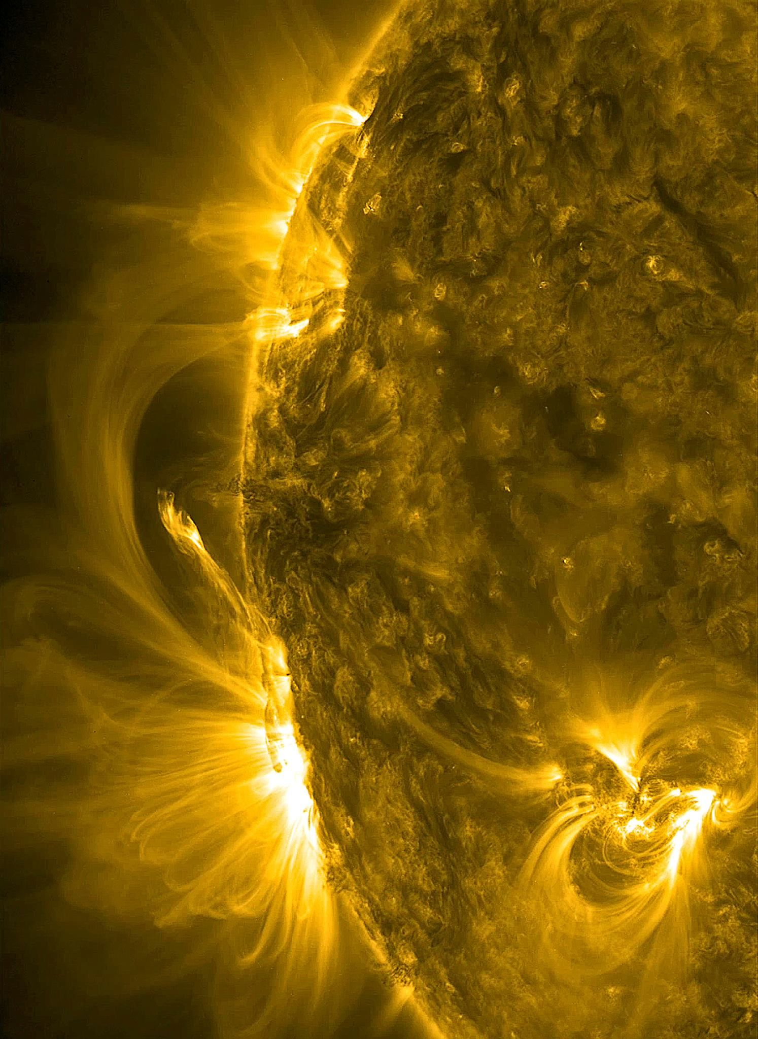 Thin ribbons of plasma and magnetic lines burst from the sun in one of our Space Photos of the Week.