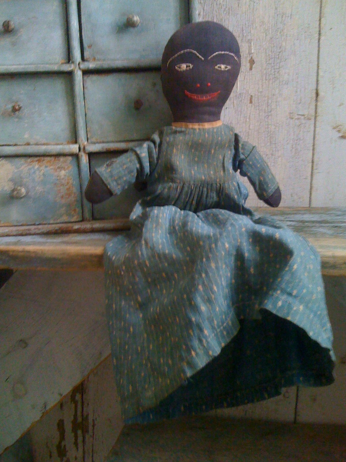 19Th Folky  Cloth Doll with stitched facial features.