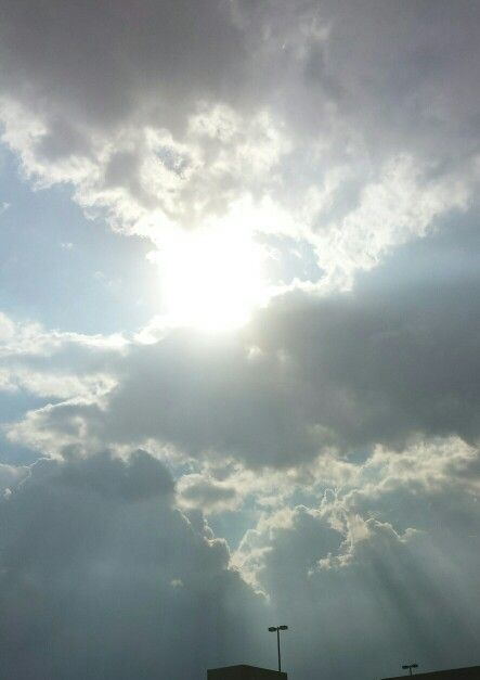 The sun coming from behind the clouds ...you can see the ray's of light
