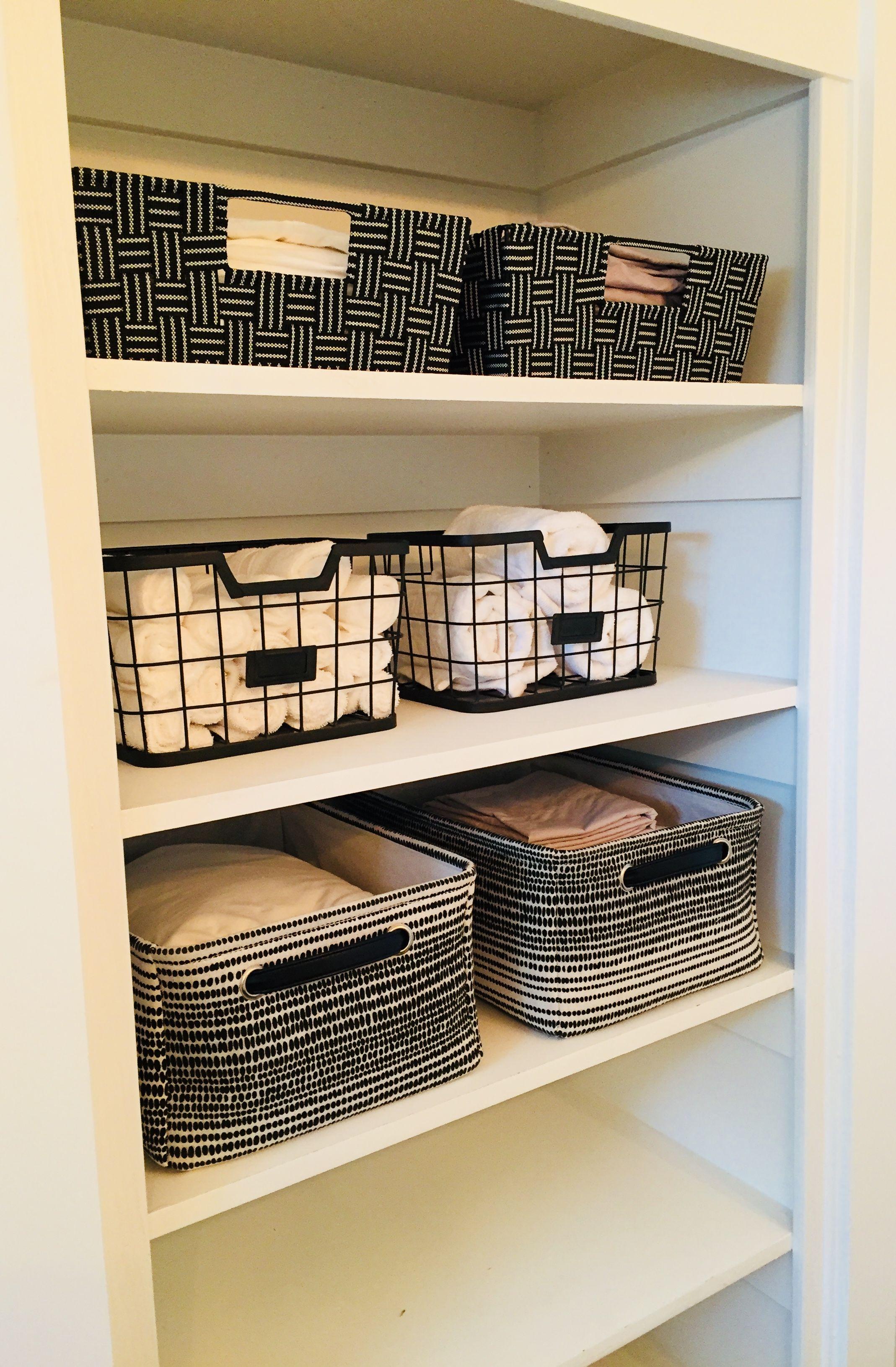 Linen Closet Organization Open Concept Storage Becomes Part Of The Decor Ditch The Door And Take It U Modern Closet Organizers Bathrooms Remodel Linen Closet