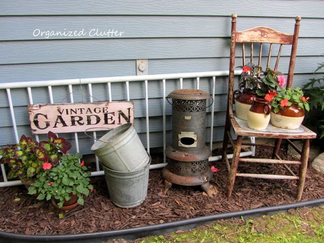 Adding rustic vintage decor to the garden. The flamingoes better play nice.  - Gardening For You - Garden Junk Doesn't Last Forever Via OrganizedClutter.net Backyard